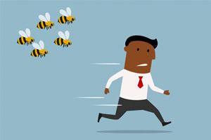 Cartoon-Businessman-Running-From-Bees